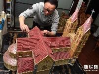 """青岛市民用贝壳""""还原""""特色建筑"""