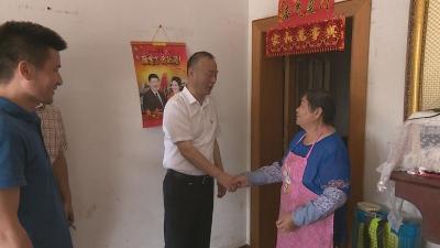 汪强走访慰问困难党员